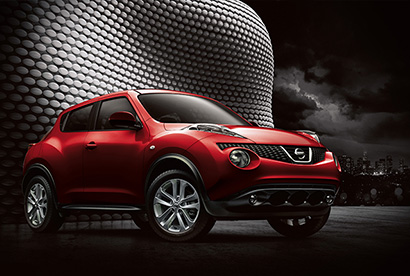 red nissan juke outside at night